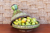 Argan nuts in a green plate. — Stock Photo