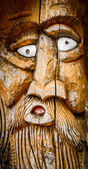 Face Carved Into Wood — Stock Photo