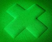 Green Fabric Cross — Stock Photo
