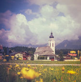 Retro Style Alpine Village With Flowers — Stock Photo