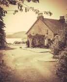 Vintage Style Photo Of Rural Cottage By The Sea — Stock Photo