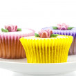 Cupcake selection on white china stand — Stock Photo