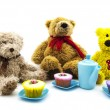 Teddy bears picnic with tea and cakes over a white background — Stock Photo