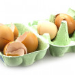 Boken egg shells in cardboard egg box — Stock Photo