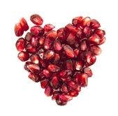 白色背景上的石榴籽的心 — 图库照片