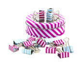 Stripey Tin wth foldback cilps of a white baground — Stock Photo
