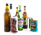 Collection of empty cans and bottles on a white background — Stock Photo