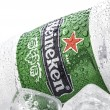 Постер, плакат: Cold can of Heineken Beer on ice overa white background