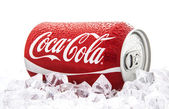 Can of Coca-Cola on a bed of ice over a white background — Stock Photo