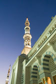 Tower of the Nabawi Mosque at knight. — Stock Photo