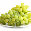 White grapes on white plate — Stock fotografie