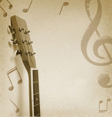 Musicla backgorund with guitar — Stock Photo