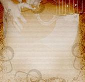 Hudební pozadí s kytarou — Stock fotografie
