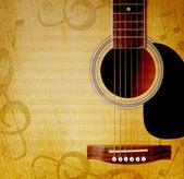 Muzikale achtergrond met gitaar — Stockfoto