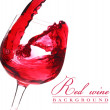 Red wine flow in a glass - Stockfoto
