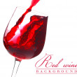 Red wine flow in a glass on white background - Stockfoto