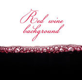 Bubbles of young red wine with space for text — Stockfoto