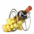 White wine bottle in metallic support and grapes - Stock Photo