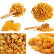 Golden raisin collage with wooden spoon - Stockfoto