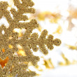 Golden snowflake closeup as winter background — Stock Photo