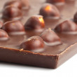 Whole chocolate with nuts background — ストック写真