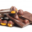 Chocolate pieces with nuts on white — Stockfoto