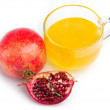 Pomegranate and honey in cup of glass — Stock Photo #23774889