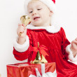 Little girl as Santa Claus with Christmas presents — Stock Photo #13585578