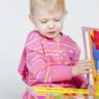Little girl with a book — Stock Photo #13585652