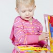 Stock Photo: Little girl with a book