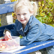 Little girl at picnic — Stock Photo