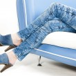 Detail of woman wearing denim clogs — Stock Photo