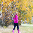 Woman wearing rubber boots in autumnal nature — Stock Photo #13586687