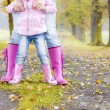Detail of mother and daughter wearing rubber boots — Stock Photo #13586798