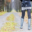 Detail of woman wearing rubber boots — Stock Photo #13587215