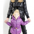 Mother and daughter wearing jackets and black boots — Stock Photo #13587415