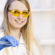 Portrait of young woman in laboratory — Stock Photo