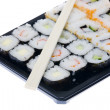 Sushi with chopsticks isolated over white background - Foto Stock