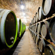 Beautiful photo of a wine cellar with barrels in stacks - Stock Photo