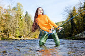 Woman fishing in Otava river, Czech Republic — 图库照片