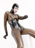 Sitting woman wearing latex clothes — ストック写真