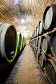Beautiful photo of a wine cellar with barrels in stacks — Stock Photo