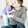 Stock Photo: Little girl kissing her father