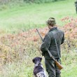 Hunter with his dog hunting — Stock Photo #14120125
