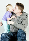 Little girl kissing her father — Stock Photo
