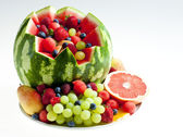 Fruit salad in water melon — Stock Photo