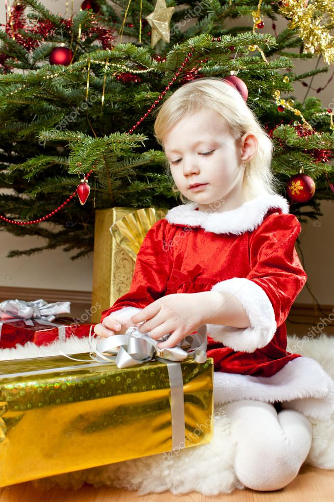 Little girl as Santa Claus with Christmas presents — Photo #14120144