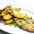 Grilled mackerel with roasted potatoes - Stock Photo