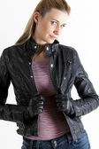 Portrait of standing woman wearing black jacket — Stock Photo