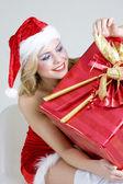 Santa Claus with Christmas present — Stockfoto